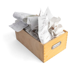 """Overfilled box of receipts for filing taxes and deductibles. Wooden storage box with """"Receipts"""" label. Isolated on white."""