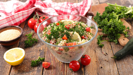 Fotobehang - tabbouleh salad with couscous and vegetable
