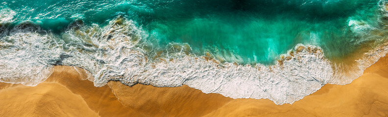 Beautiful sea wave at sunset from a bird's eye view. Beautiful lonely beach at sunset. Aerial view of turquoise ocean waves in Kelingking beach, Nusa penida Island in Bali, Indonesia. Beaches of Bali Fotomurales