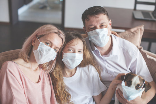 Happy family at home in mask during the pandemic coronavirus