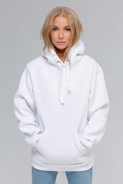 Woman in white hoodie, mockup for logo or branding design