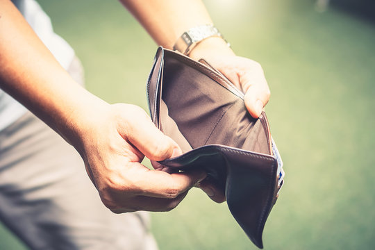 Poor man hand hold empty wallet no money due to economic finance depression crisis after coronavirus outbreak went bankrupt with no cash money job unemployed need government support advice to pay bill