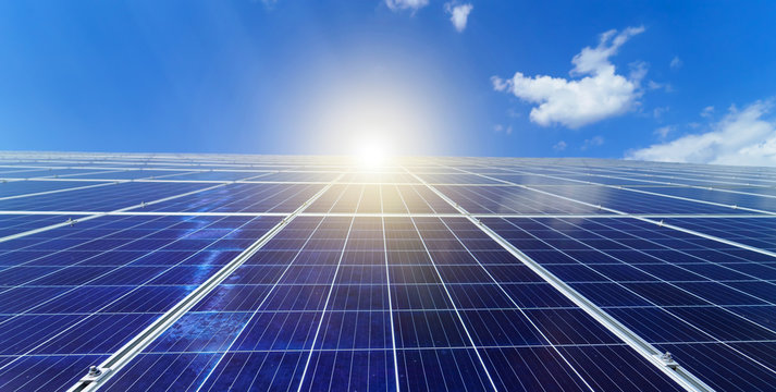 Solar panels. Power station. Blue solar panels. Alternative source of electricity. Solar farm. The source of ecological renewable energy.
