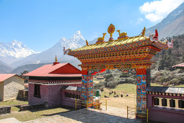 Obraz Tengboche Monastery (or Thyangboche Monastery), also known as Dawa Choling Gompa. Monastery's entrance with Ama Dablam and Lhotse mountain peaks in the background. - fototapety do salonu