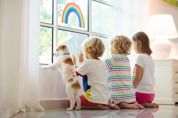 Coronavirus quarantine. Kids at window. Stay home. Fototapete