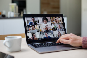 Person Using Video Conferencing technology in kitchen for video call with colleagues at home and in offices Wall mural