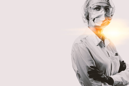 female doctor in medical mask on the face and gloves on a white background