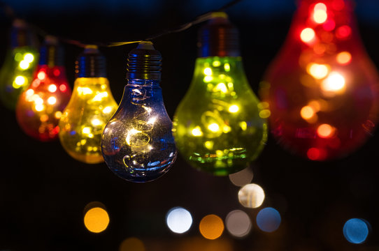 Chain of Colourful Light Bulbs by Night