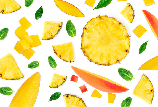 Mango Pattern. Fresh Mangoes pieces with pineapple chunks and leaves isolated on the white background.