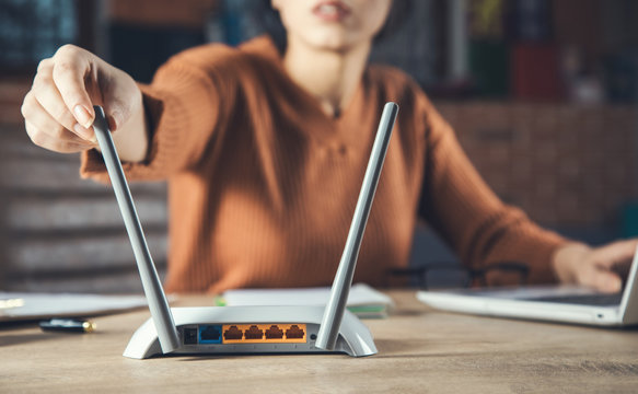 woman hand wireless router