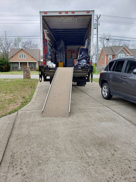 Moving Truck in Driveway.