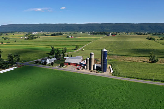 Aerial Beautiful Ohio countryside Amish farm barn silos. Settled late 1700's as pioneer religious settlement. Old Amish Mennonite town. Rural order. Farming landscape. Old Amish Mennonite settlement.