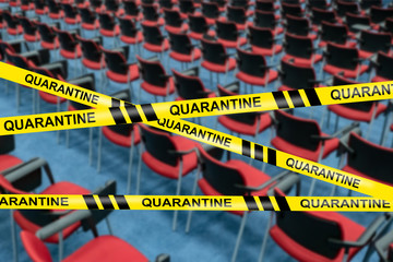 Empty concert hall. Concept - cancellation of an event due to quarantine. Inscription quarantine on the background of empty chairs. Yellow ribbon with the word quarantine.  Transferring due to fever Fotobehang