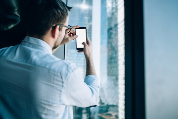 Man taking picture of office building