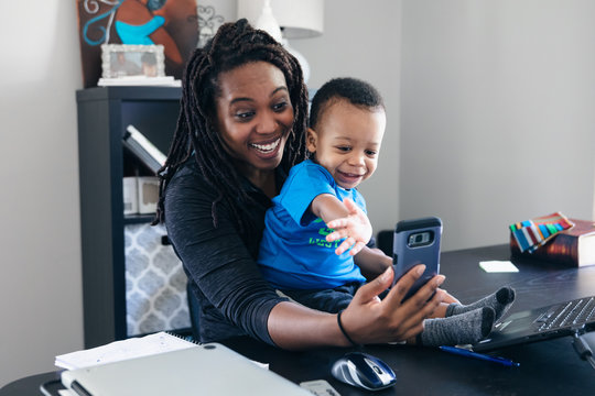 mother and son doing video chat with co-worker