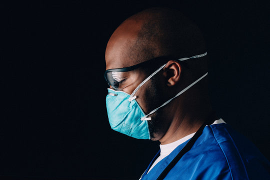 Moody portrait of medical healthcare worker wearing n95 mask
