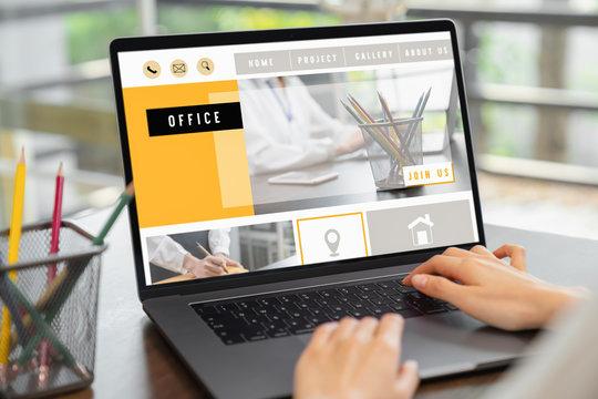 business woman using website on digital laptop on desk.