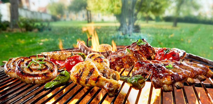 Assorted of mixed meats on a BBQ grill