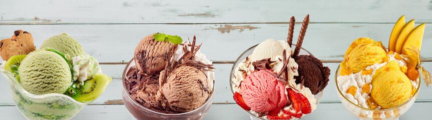 Assortment of colourful ice-cream sundae desserts Wall mural