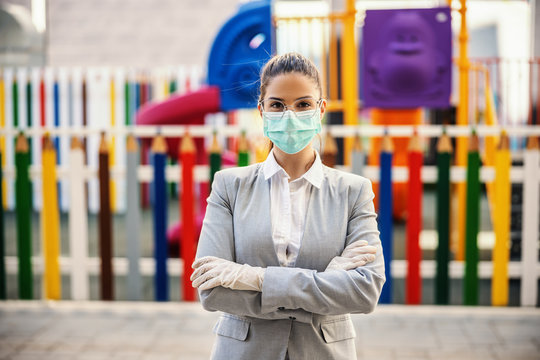 Young woman with protective mask and gloves standing in front of camera, prevent infection of Covid-19 virus coronavirus,contamination of germs or bacteria.
