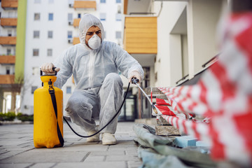 Cleaning and Disinfection outside around buildings, the coronavirus epidemic. Professional teams for disinfection efforts. Infection prevention and control of epidemic. Protective suit and mask. Fototapete