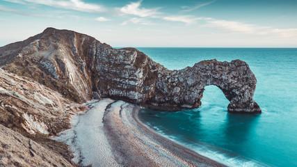 Obraz Durdle Door rocks on beach coast in Dorset, England - fototapety do salonu