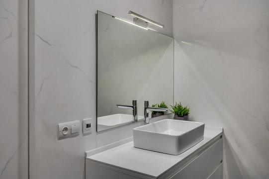 Interior of a modern loft style apartment. Marble bathroom