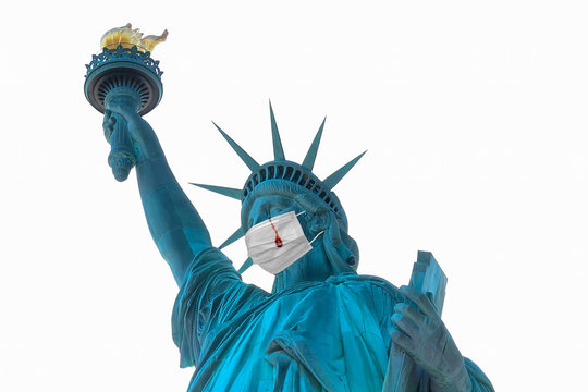 Representation of Statue of Liberty with a protective surgical mask and crying tears of blood as consequence of Covid-19 coronavirus deaths