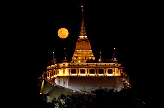 The supermoon rises above Bangkok