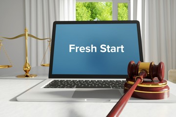 Fresh Start – Law, Judgment, Web. Laptop in the office with term on the screen. Hammer, Libra, Lawyer.