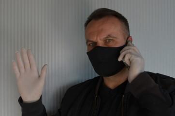 Fototapeta maseczka , koronawirus , izolacja maską , biznesmen w masce , fotograf w masce , portret w masce , rozmowa w masce , maseczka  wirusowa , maseczka, doktor, lek, medyczne, izolowany, zdrowie, bezpiecze obraz