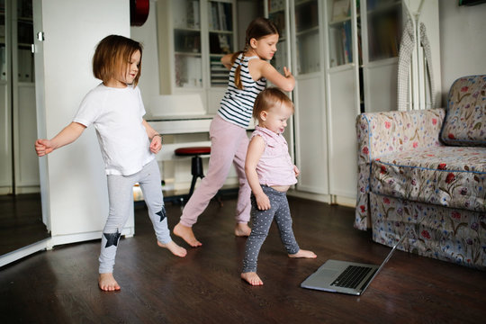 Three children dancing in video chat online