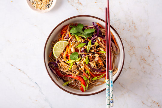 Buckwheat or soba noodle salad with vegetables and peanut sauce