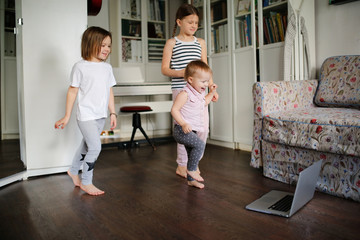Children do exercises video chat online laptop