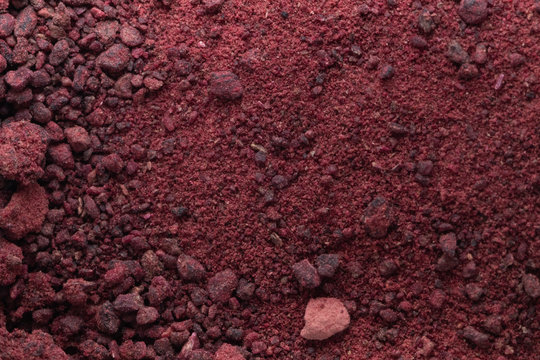 the powder of dried, shredded red beets. texture of spices