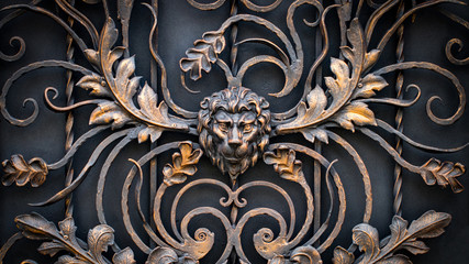 The fragment of forged metal products. lion, close-up Fotomurales