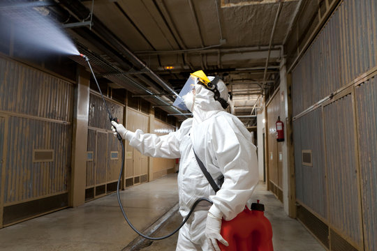 A staf member desinfects garaje