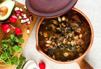 Spicy pork and hominy stew with collard greens Wall mural