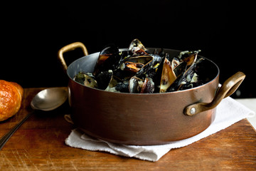 Spicy†coconut mussels with lemongrass in saucepan