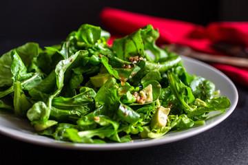Arugula and avocado salad with bagna cauda dressing