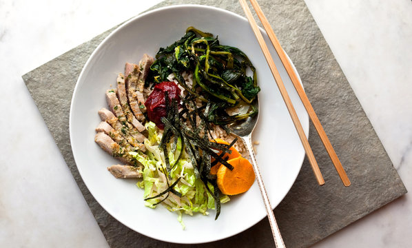 Bibimpap with tuna, sweet potato, broccoli rabe or kale and lettuce