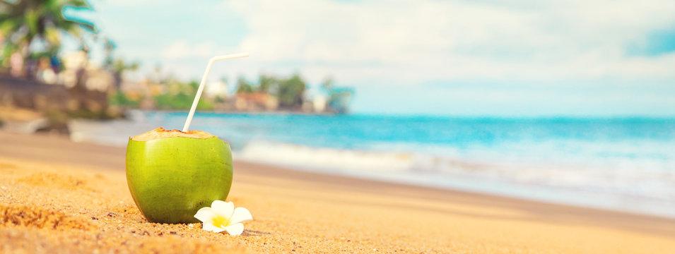 Coconut on a beach cocktail. Selective focus.