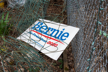 A lawn sign for Democratic 2020 presidential candidate Senator Bernie Sanders lies in a house yard in Burlington