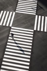 High Angle View Of Cyclist Crossing Road