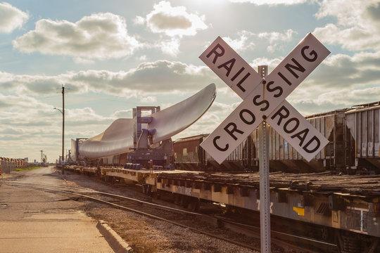 April 7, 2020 - Galveston TX/USA: Wind turbine blade on railroad train flatcar at the Port of Galveston Texas