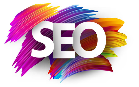 Big seo sign letters on brush strokes background.