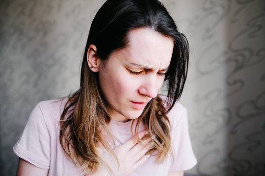 COVID-19 shortness of breath pneumonia woman with Corona virus symptoms such as