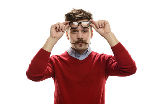 Young funny guy holding his glasses