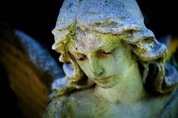 Fotomurales - Retro styled image of ancient stone statue of  wonderful angel with sweet facial expression.