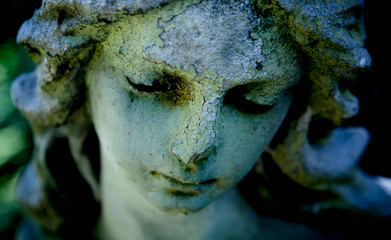 Fotomurales - Beautiful sad angel ancient stone statue with a sweet expression that looks down